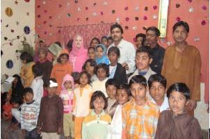 Gail and Pastor Ghaffar with orphans